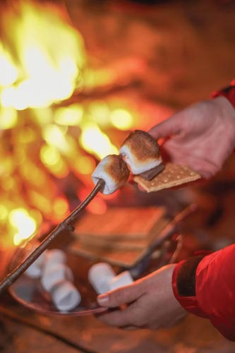 roasting marshmellows on the fire Cold weather outdoor entertaining