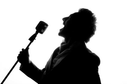 Man posing and singing in studio