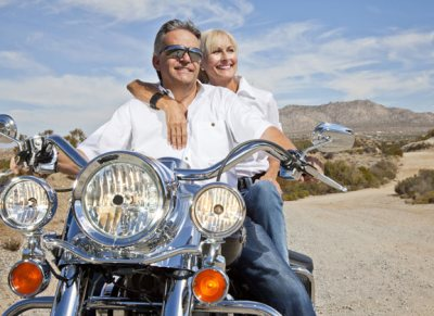 mature couple riding motorocycle