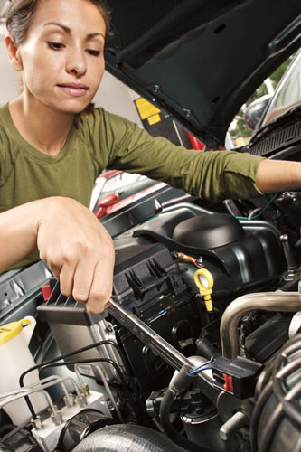 woman giving her car a tune up