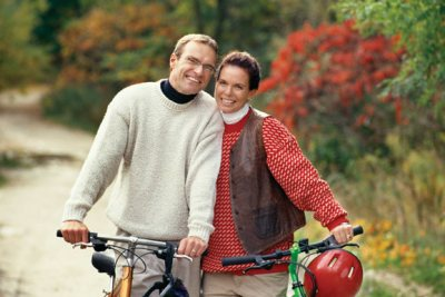 couple riding bikes in autumn