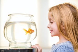girl with pet fish