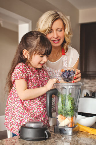 mom and child making healthy breakfast smoothie