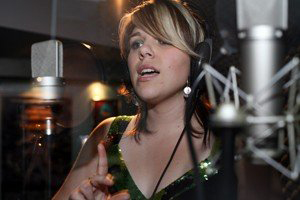 Sarah Melody in recording studio singing