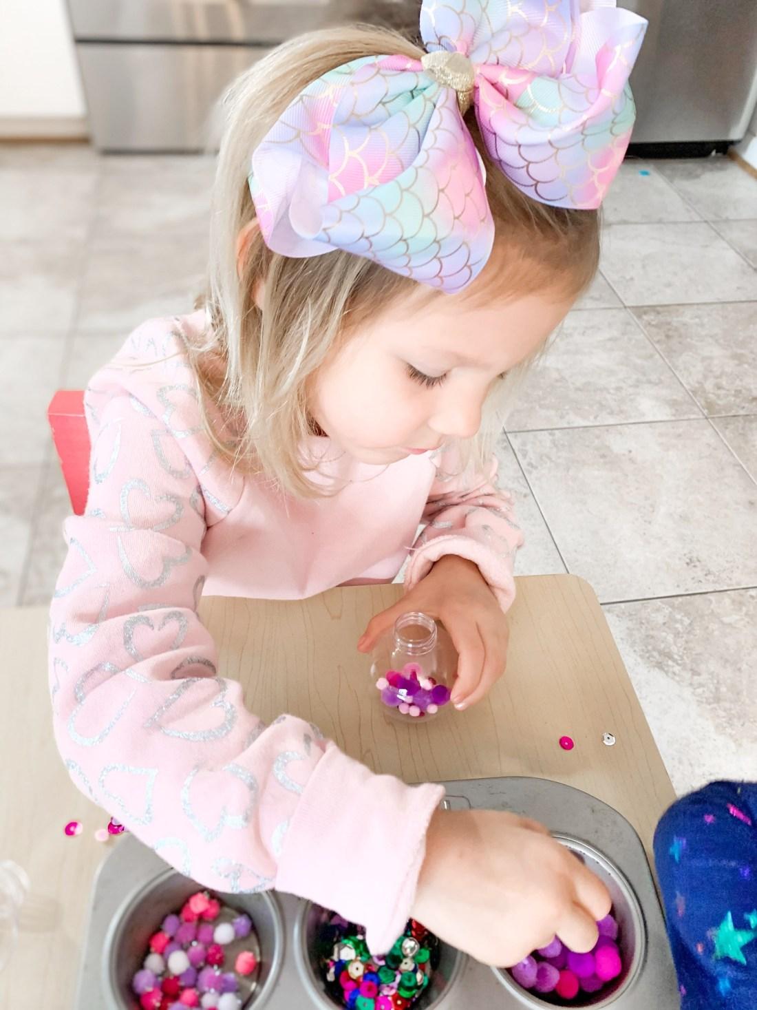 Rosie making ornaments
