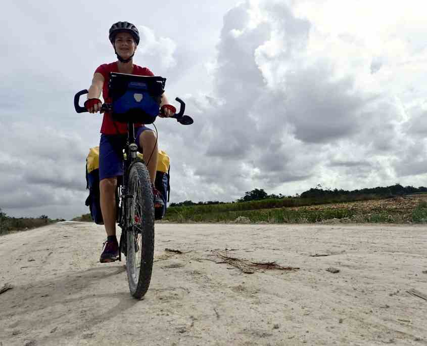 Bicycle touring through Belize - Cycling on one of Belize's dirt roads