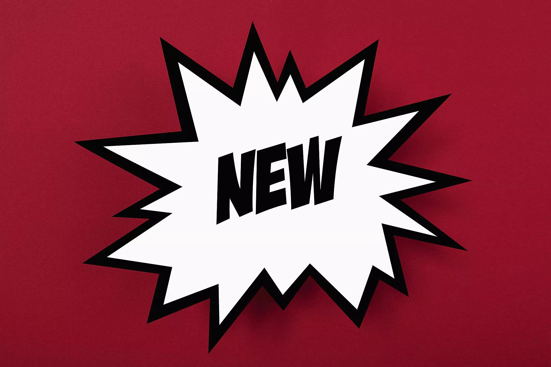 Graphic of the word NEW in an explosion, on a red background - The Internet Tips