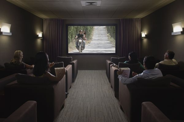 A family watching movies in a home theater.