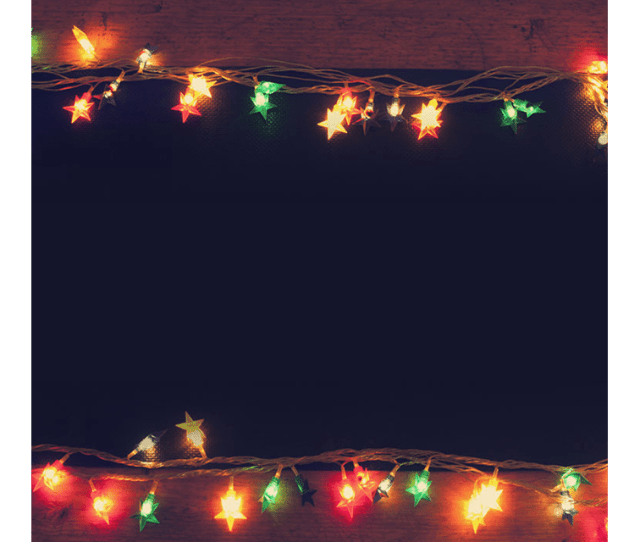 An Email Stationery Featuring Christmas Lights On A Wooden Table Email Backgrounds