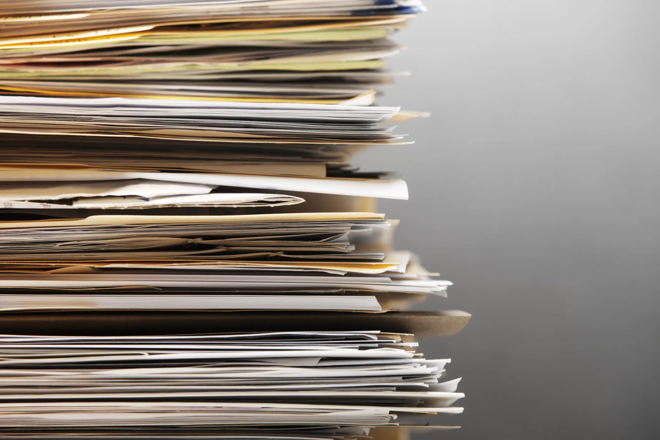 Photo of a stack of files and paper - The Internet Tips