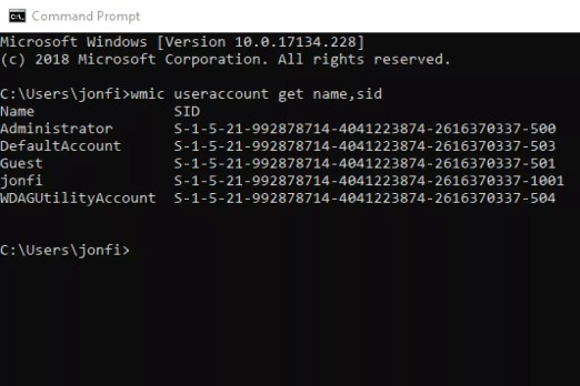 Screenshot of the wmic useraccount get name,sid command in Windows 10 Command Prompt