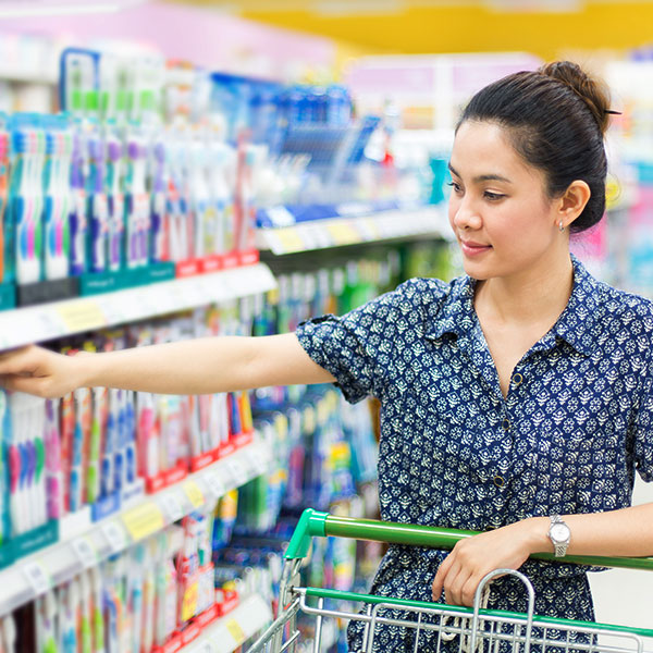 Woman shopping at grocery store, your in-kind donations help survivors as they rebuild their lives