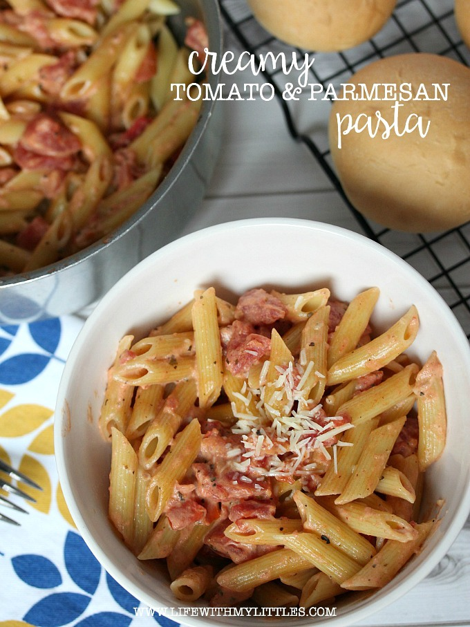 This creamy tomato and parmesan pasta is super easy and can be on the table in 25 minutes! A great meatless dinner idea for those busy weeknights!