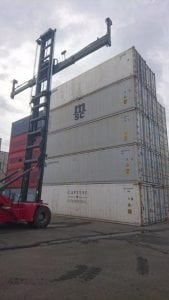Shipping container being moved