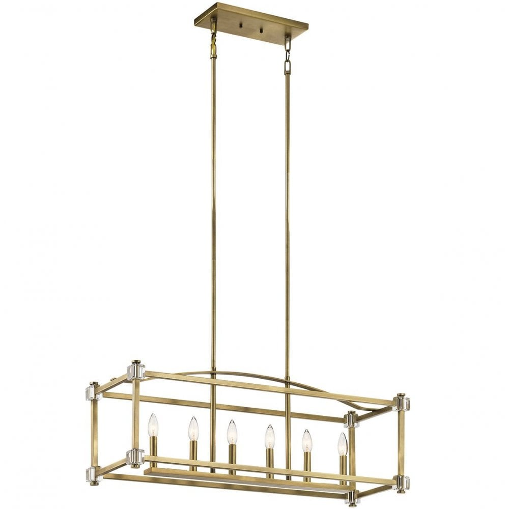 cayden 6 light linear chandelier over table light in a natural brass colour
