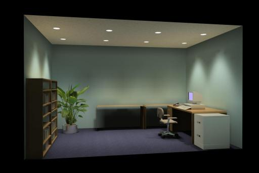 Office lighted by downlights.