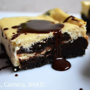 Chocolate Brownie Swirl Cheesecake Slice. Chocolate cookie base, creamy, tangy, vanilla, baked cheesecake with rich, chocolate brownie swirled through the bottom cheesecake layer. So good! #browniecheesecake #recipe #cheesecakebars