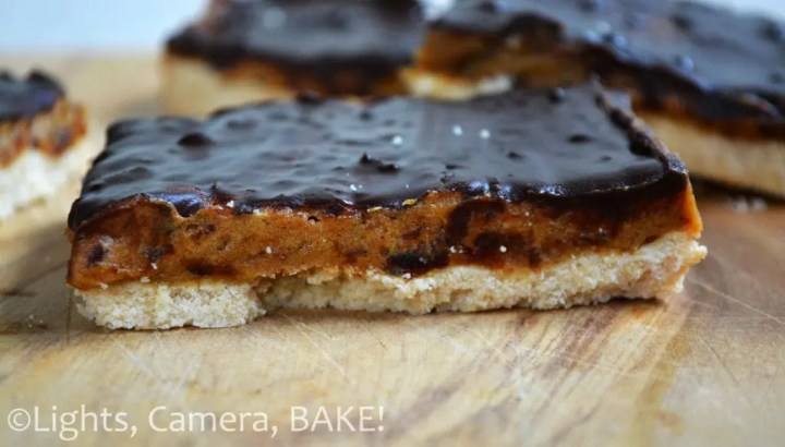This Paleo Butterscotch Slice is a shortbread base with a caramel filling topped with a soft chocolate ganache. This is dairy free, grain free, refined sugar free and gluten free! #Recipe #paleobaking #refinedsugarfreebaking