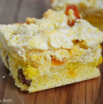 Apricot and Walnut Custard Slice. A shortbread style base and top with dried apricots and walnuts and a simple custard filling. Super delicious and melts in the mouth! #apricotwalnutslice #apricotwalnutbars #custardslice #custardshortbread