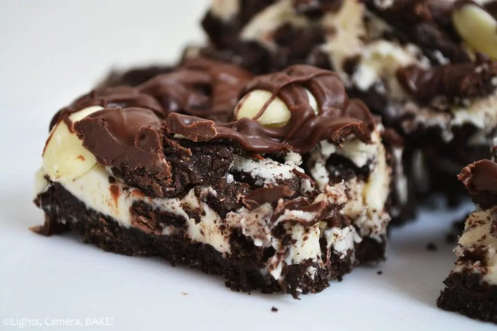 No Bake Cookies and Cream Slice: We take a simple crushed Oreo base, top that with a white chocolate, Oreo, cream cheese mixture and finish all that off with more Oreos, chocolate and a melted chocolate drizzle.