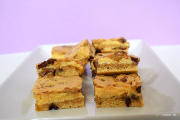 Slices of caramel filled cookie bars.