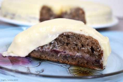 Raspberry Banana Cake with Cream Cheese Icing. Slice of banana cake with a raspberry jam filling.