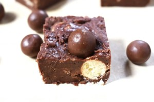 Close up of the Malteser fudge. This is a cheat, quick and easy malted chocolate fudge recipe filled to the brim with Maltesers. A quick and easy no bake treat with only five ingredients.