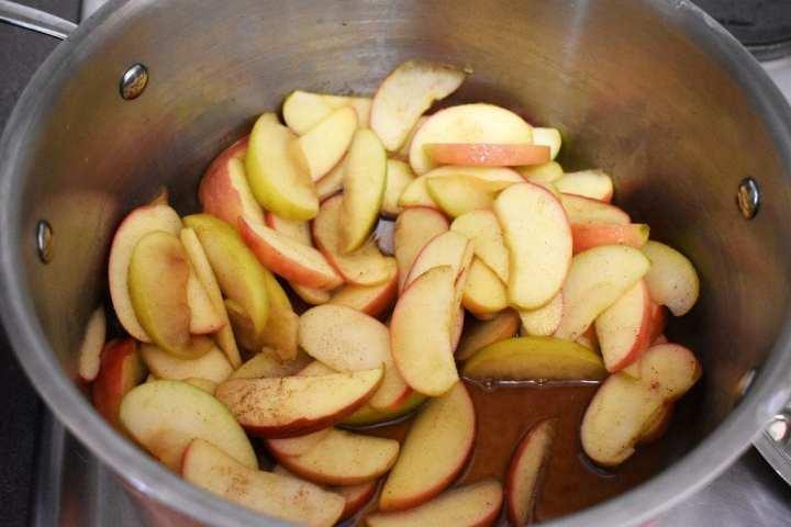 Apple Butter process shot. Sliced apples to cook down. #applebutter #applebutterrecipe #stovetopapplebutter