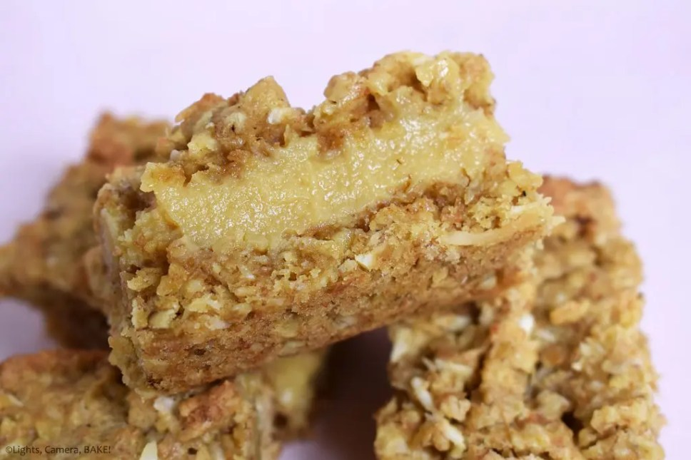 Buttery Caramel Oat Slice.... These bars are a soft and crunchy oat base and top with a THICK layer of buttery caramel sandwiched in between! This recipe is an absolute crowd pleaser and I have had so many requests for this recipe I've actually lost count. #butterycarameloatslice #carameloatslice #caramelslice #condensedmilkcaramel