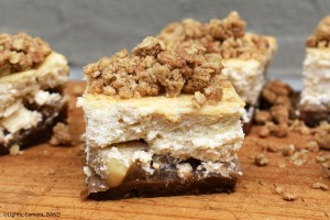 Apple Crumble Cheesecake is a baked, spiced cheesecake with a spiced ginger nut and digestive biscuit (Graham Cracker) base and covered in baked apples and topped with a crisp crumble. #applecrumble #cheesecake #spicedcheesecake #applecheesecake #applecrumblecheesecake #bakedcheesecake