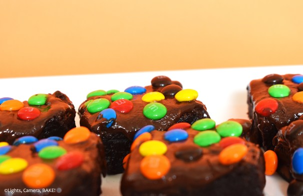 Flourless Cosmic Brownies on a white plate with an orange background.