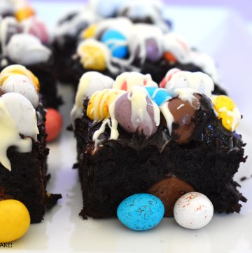 Mini Easter egg brownies on a white plate.