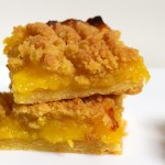 Lemon curd crumble slice on white background.
