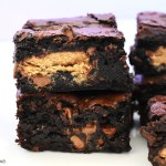 Stack of peanut butter cup brownies.