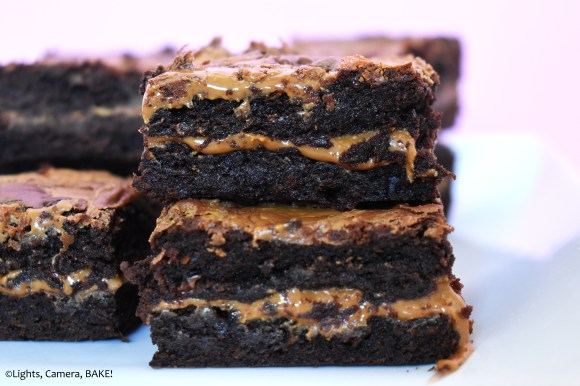 Cookie butter swirled brownies stacked up.
