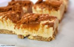 Slice of Biscoff Cheesecake covered in cookie butter.