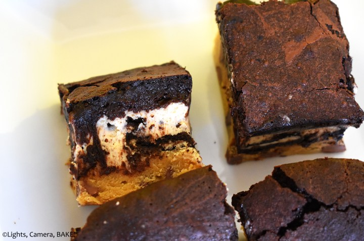 Cheesecake filled brownies and cookie bars on a white plate.