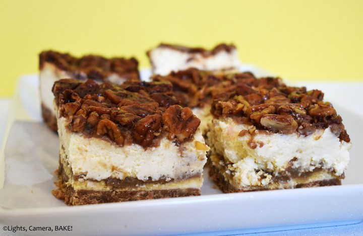 Pecan pie cheesecake slice on a yellow background.