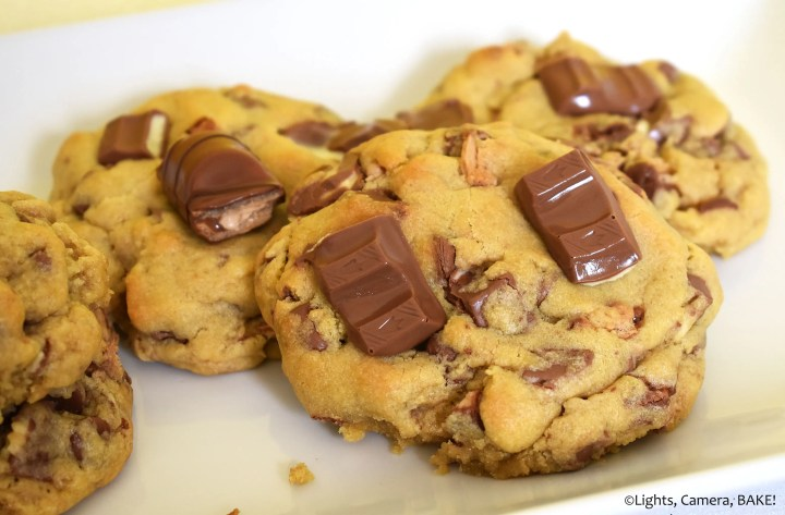 Stack of Kinder Bueno cookies on a white plate.