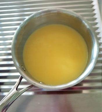 Lemon curd in a saucepan.