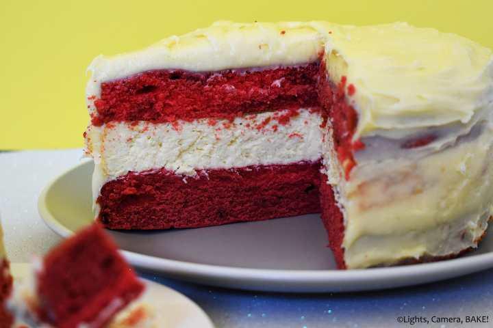 Red velvet cheesecake cake on a plate.