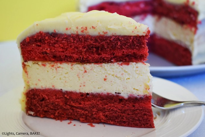 Piece of red velvet cheesecake cake on a plate.
