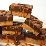 Slices of Biscoff chocolate fudge on a white background.