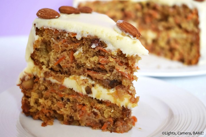 Slice of carrot cake with cream cheese icing.