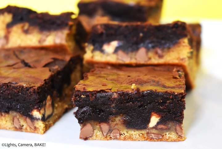 Pieces of caramilk chocolate layered brownies on a plate.