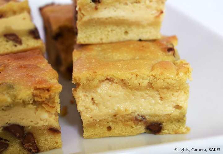 Caramilk cheesecake stuffed cookie bars on a plate.