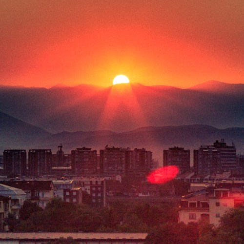 Photo by Dzvonko Petrovski. Note how the image is separated in thirds. The sky is roughly one third, the layering in the mountains is roughly one third, and the rest of it is the city.