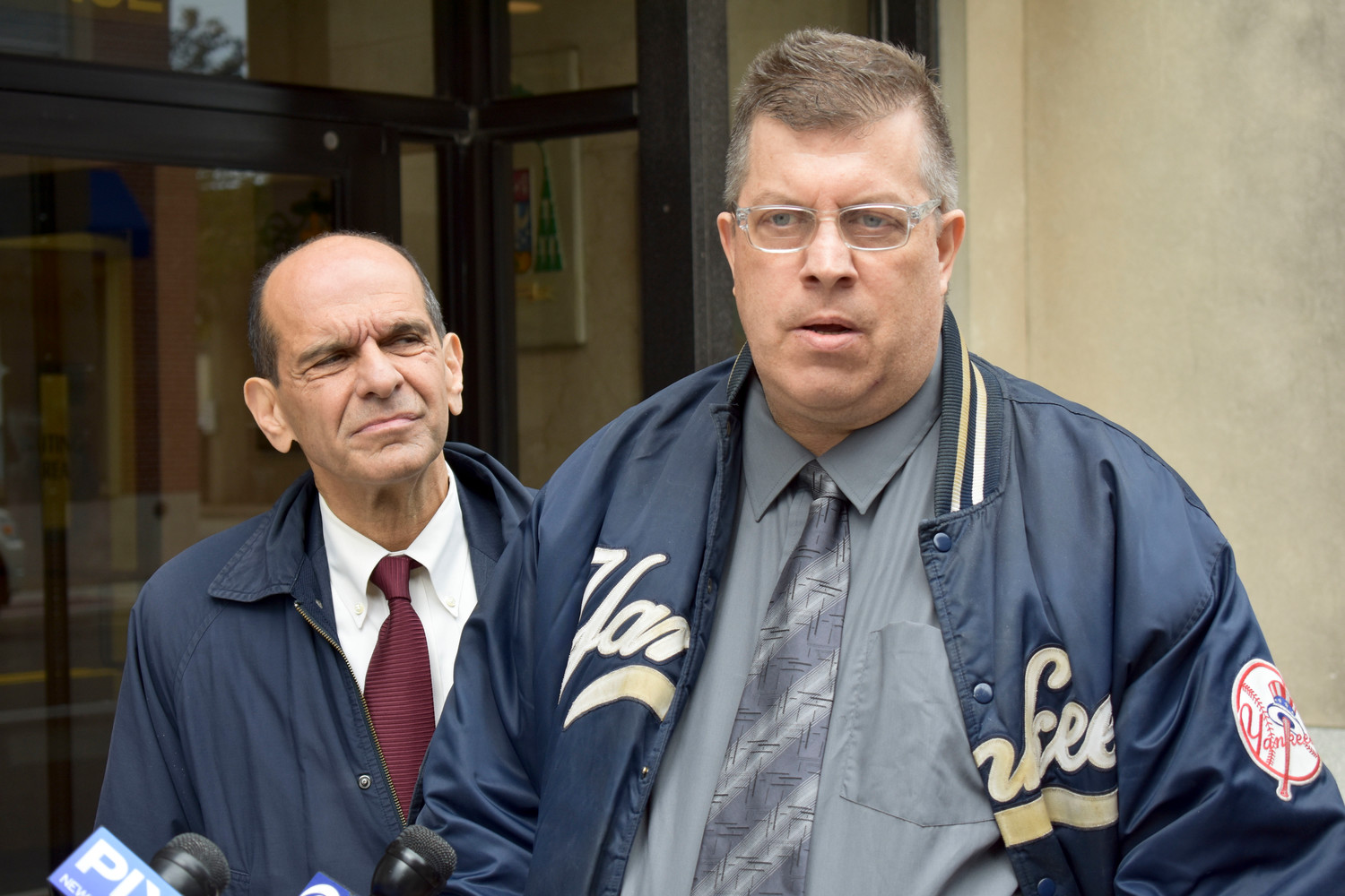 Alleged victims like Thomas McGarvey, right, who grew up in Franklin Square, will have more time to submit claims of clergy sexual abuse to the Diocese of Rockville Centre. McGarvey alleged that a priest sexually abused him at St. Catherine of Sienna Church over eight years at a news conference outside the Diocese of Rockville Centre's headquarters in October. Boston attorney Mitchell Garabedian, left, who has handled hundreds of sexual abuse cases, is representing him.