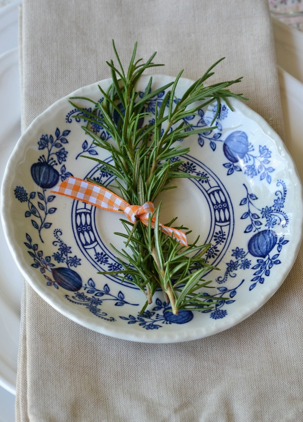 blue and white plate with rosemary sprigs and gingham ribbon