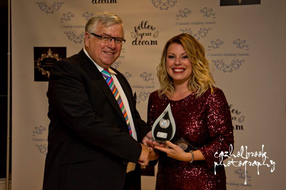 Image of Louise Hickman (founder of Lilly Dilly's) receiving her award